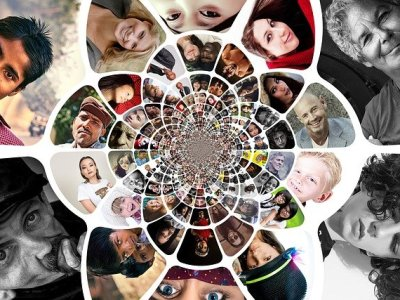 Lots of faces interwoven into a never ending spiral signifying how connected we all are in the modern world
