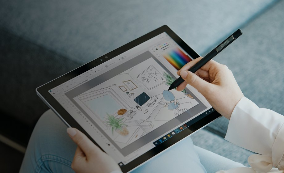 A person using a drawing tablet